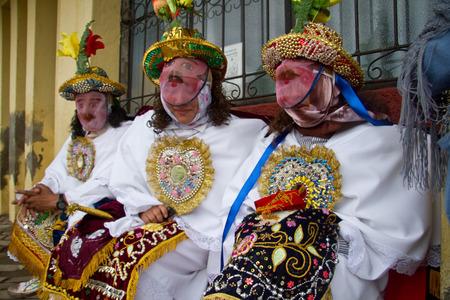 indigenous: CHIMBORAZO, ECUADOR - JUNE 20, 2010: Unidentified dancers at Inti Raymi indigenous celebration in Chimborazo province, Ecuador