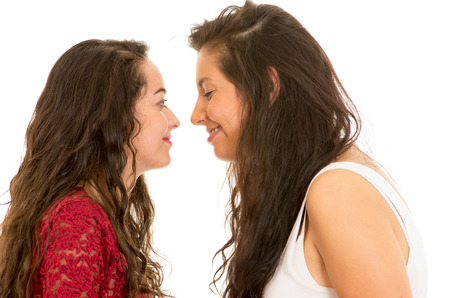 portrait of beautiful lesbian couple in love in front of each other isolated on white concept of love Stock Photo