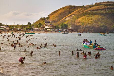 sua: SUA, ESMERALDAS, ECUADOR - JANUARY, 1, 2013: Unidentified tourists enjoying the beach of Sua.