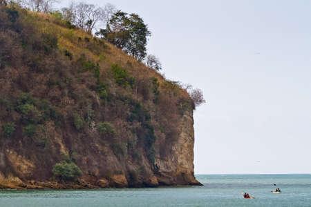 sua: SUA, ESMERALDAS, ECUADOR - JANUARY, 1, 2013: Unidentified tourists enjoying the beach of Sua kayaking.
