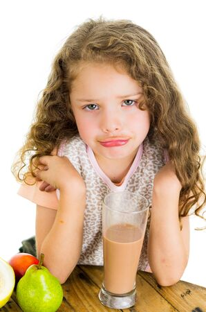 milk mustache: Cute little preschooler girl with chocolate milk mustache isolated on white Stock Photo