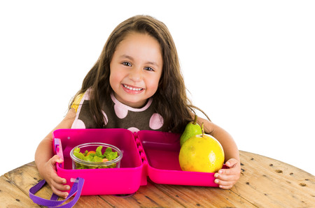 Cute little brunette girl with her healthy lunchbox isolated on white Zdjęcie Seryjne - 38114707