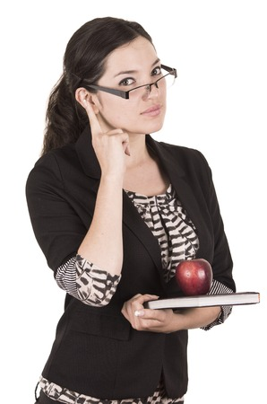 pay attention: sweet female teacher holding red apple gesturing pay attention isolated on white