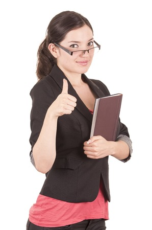 great job: portrait of pretty female teacher wearing glasses and holding book gesturing good job isolated on white