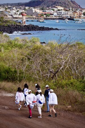 GALAPAGOS, ECUADOR - JULY 19, 2010: Group of unidentified tourists hiking along San Cristobal Island in Galaagos.