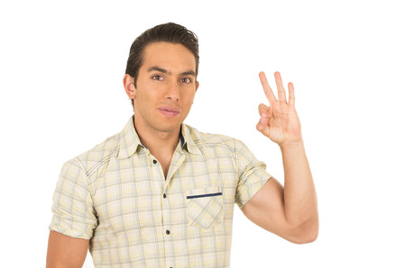 allright: young handsome hispanic man posing gesturing all right isolated on white Stock Photo