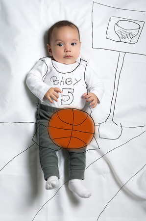 Cute infant baby boy playing basketball sketch photo