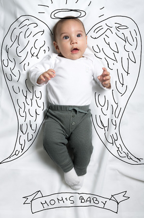cute babies: Cute infant baby boy with angel wings sketch Stock Photo