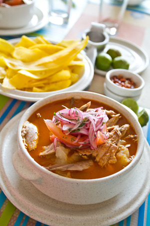 ecuadorian: Encebollado, fish stew, served with banan chips and lemon. Typical ecuadorian dish, Ecuador.
