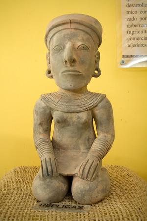 indian artifacts: Replica figurine in archaelogical museum in Santa Elena, Ecuador Editorial