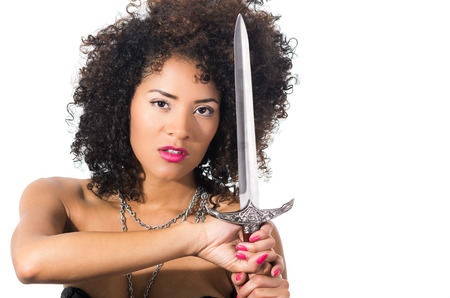 tribal woman: close up shot of beautiful exotic young tribal woman holding a dagger sword isolated on white Stock Photo