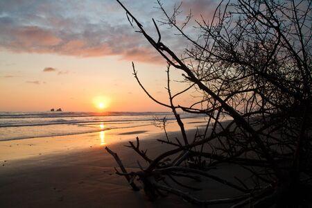 ruta: Breathtaking view of amazing sunset in a beautiful beach of Manabi, Ecuador
