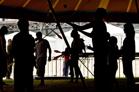 circus performers: Silhouette of circus performers practicing juggling before the show