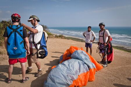 paraglide: MANABI, ECUADOR - MAY 28, 2011: Unidentified tourists preparing to paraglide over the beautiful beach of Canoa.