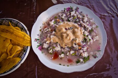 ecuadorian: Fish ceviche, typical ecuadorian dish served with plantain chips Stock Photo
