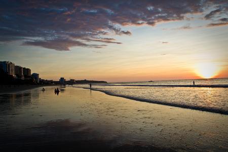 touristic: Beautiful clear sunset in touristic Murcielago beach, Manta, Ecuador Stock Photo