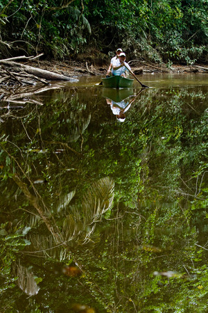 riverine: ORELLANA, ECUADOR - AUGUST 12, 2012: Unidentified tourists canoeing in river at amazon rainforest, Yasuni National Park, Orellana, Ecuador Editorial