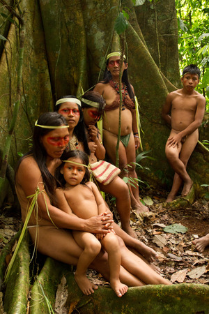 ORELLANA, ECUADOR - AUGUST 10, 2012: Huaorani tribe in the amazon rainforest, Yasuni National Park, Ecuador