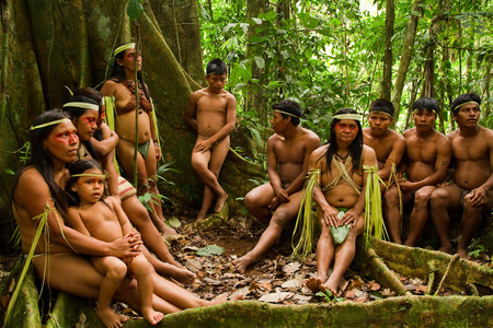 ORELLANA, ECUADOR - AUGUST 10, 2012: Huaorani tribe in the amazon rainforest, Yasuni National Park, Ecuador