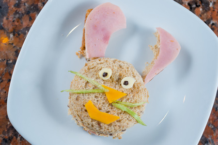 A funny cute bunny made out of bread, ham,cheese and letttuce