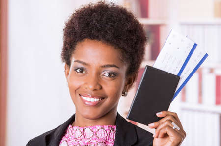 to depart: Black office woman showing tickets to camera concept transport airplane airline bus train traveling airport counter depart flight