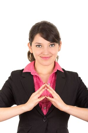 fingertips: Hispanic woman in pink shirt and black blazer jacket facing camera smiling putting fingertips from both hands together.
