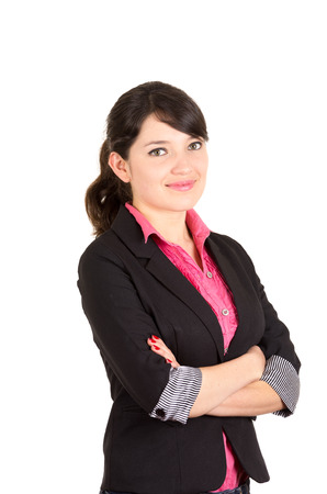 hispanic: Hispanic woman in pink shirt and black blazer jacket with arms crossed side angle.