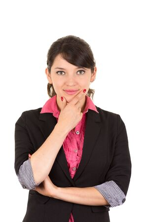 looking into camera: Hispanic woman in pink shirt and black blazer jacket with thoughtful facial expression looking into camera. Stock Photo