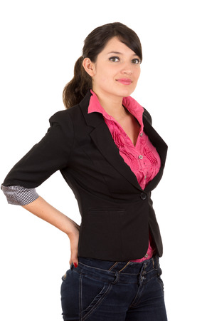 hispanic: Hispanic woman in pink shirt and black blazer jacket upper body shot arms placed behind lower back looking at camera.