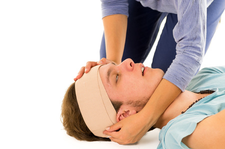 drowsy: Male head with bandage and drowsy eyes lying down while female hands holding.