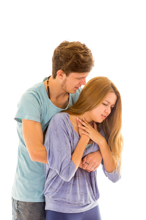 manoeuvre: Couple demonstrating first aid procedure for abdominal thrusts, Heimlich Manoeuvre or Maneuver to treat woman choking by foreign objects