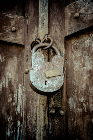 circumspect: old lock with key hole on a wooden door