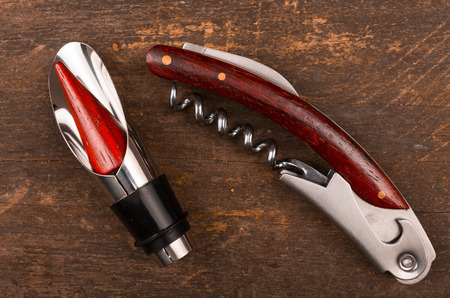 the opener: wine opener set on a wood background