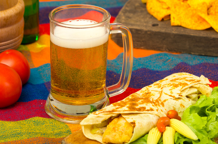 burrito: beer and burrito, mexican food served Stock Photo