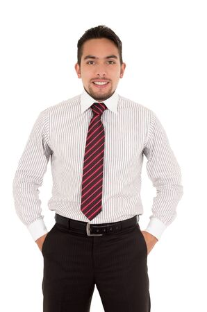 elegant young man in a tie with hands in pockets isolated over white