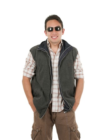 vest in isolated: young man posing with hands on pockets wearing sunglasses and vest isolated over white Stock Photo