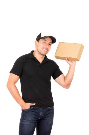 man carrying box: happy cute friendly confident delivery man carrying box with hand on pocket isolated on white Stock Photo