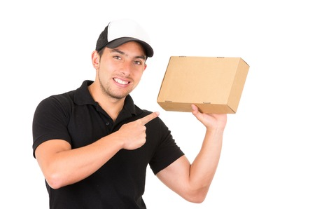 man carrying box: happy friendly confident delivery man carrying box and pointing isolated on white