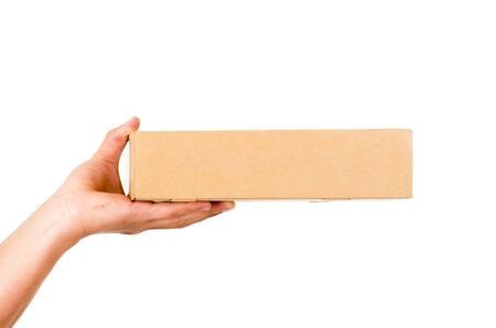 delivery box: hand of delivery man holding a box isolated on white Stock Photo