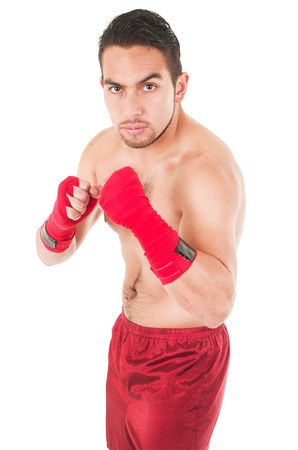 red shorts: latin martial arts fighter wearing red shorts and wristband training isolated on white Stock Photo