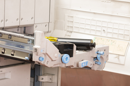 compartment: closeup shot digital photocopier machine with open tray compartment