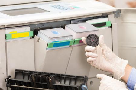 fotocopiadora: closeup shot hands of technician fixing broken photocopier machine Foto de archivo