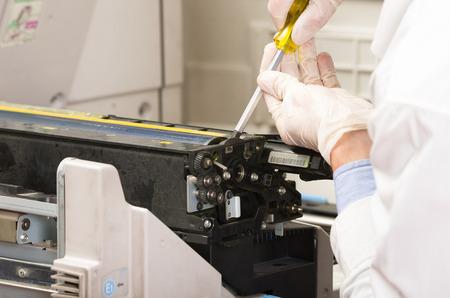 closeup shot technician fixing digital photocopier machine Archivio Fotografico