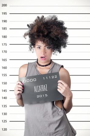 Hispanic Brunette Model Afro Like Hair Wearing Grey Sleeveless