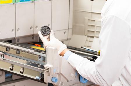 photocopier: closeup shot of technician fixing photocopier machine