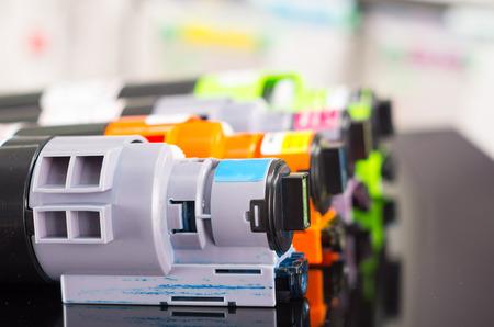 Photocopier printer cartridges cmyk closeup shot, selective focus