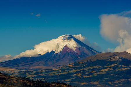 spews: Majestic Cotopaxi volcano erupting spews ash cloud in Ecuador, South America Stock Photo