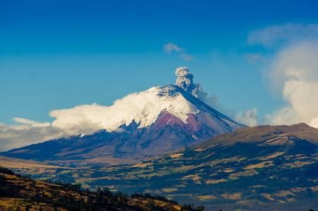 erupting: Majestic Cotopaxi volcano erupting spews ash cloud in Ecuador, South America Stock Photo