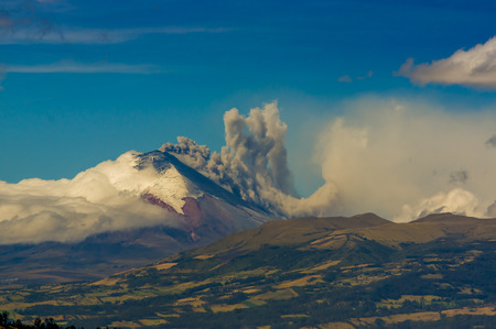 spewing: Eruption of majestic Cotopaxi volcano spewing ash cloud in Ecuador, South America