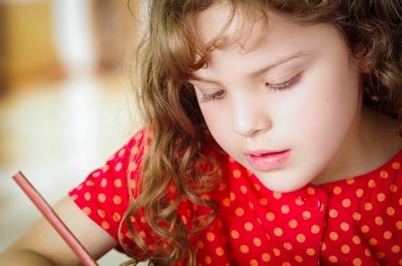homework student: Cute little girl doing her homework coloring Stock Photo